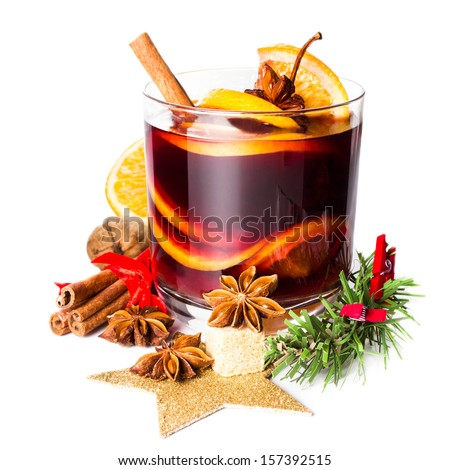Christmas Hot mulled wine for winter with spices isolated on white background, closeup. - stock photo