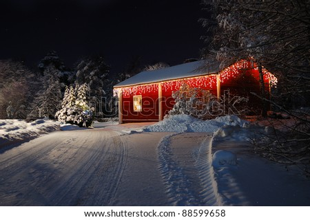 Christmas house decorated with fairy lights - stock photo
