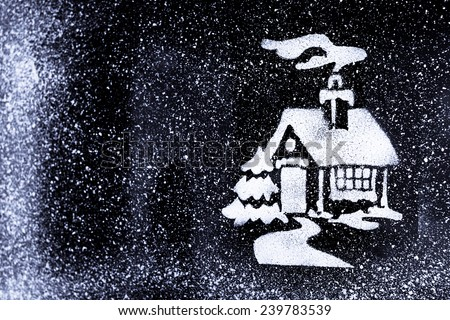 Christmas house pattern on window - stock photo