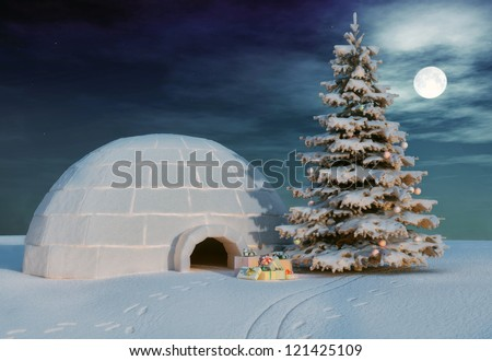 christmas igloo at the evening - stock photo