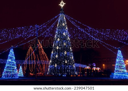 Christmas illuminations in the city. - stock photo