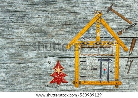 Christmas in a newly built house. Gift on Christmas Eve. Mortgage to build a house. The construction of the building.
