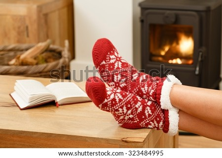 Christmas in front of fire - stock photo
