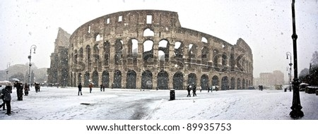Christmas in Rome - a day of snow at colosseum, italy