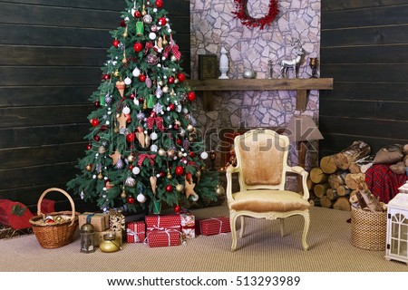 Christmas interior in the photo studio. The decorated Christmas tree, fireplace and gifts.