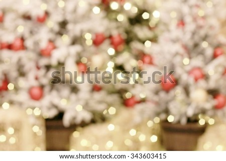 Christmas is a time of love To celebrate the birth of the child, little Jesus. Pictures of hope that God cares for human sin. The Christmas tree is decorated in a shopping mall blurred background. - stock photo