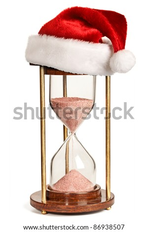 Christmas is coming concept - hourglass  with Santa Claus hat isolated on white background - stock photo