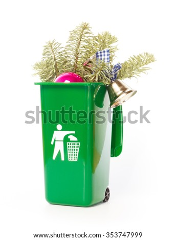 Christmas is over and the tree in the green wheelie bin - stock photo