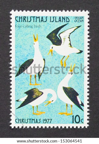 CHRISTMAS ISLAND - CIRCA 1977: a postage stamp printed in Christmas Island showing an image of four calling birds the fourth gift from the Twelve Days of Christmas, circa 1977.