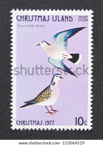 CHRISTMAS ISLAND - CIRCA 1977: a postage stamp printed in Christmas Island showing an image of two turtle doves the second gift from the Twelve Days of Christmas, circa 1977.