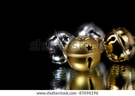 Christmas Jingle Bell on black background - stock photo