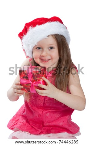 Christmas kid in Santa hat  with a Christmas gift on white background