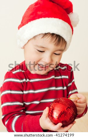 Christmas kid with red bauble