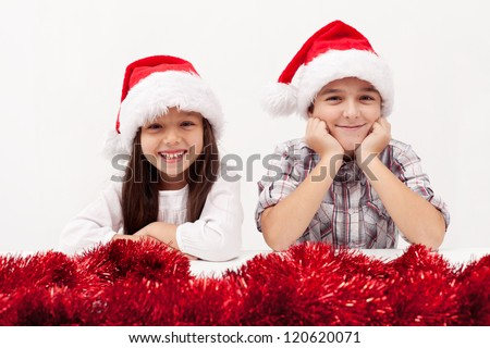 Christmas kids with red garland smiling white baclground - stock photo