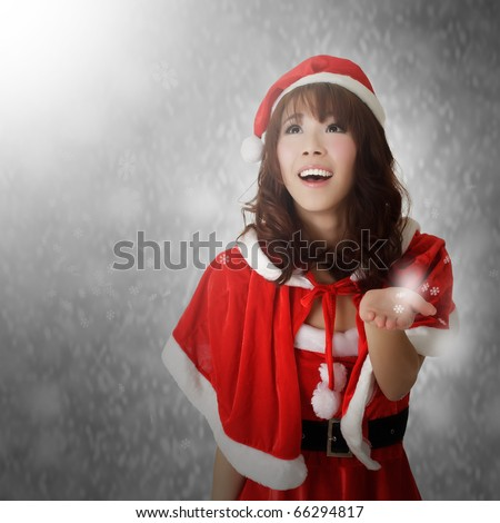 Christmas lady with happy and smiling face watching snowflakes. - stock photo