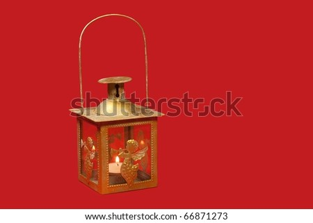 Christmas lamp over red background - clipping path - stock photo