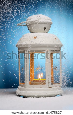Christmas lamp. Shallow dof.  Focused on fire. - stock photo