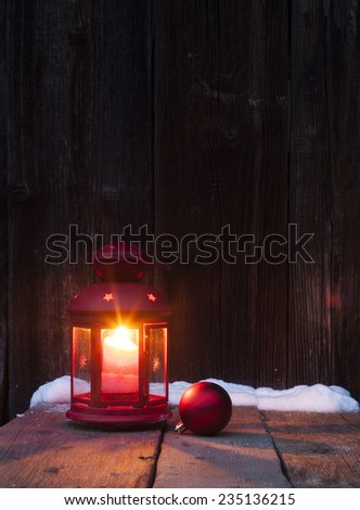 Christmas lantern and bauble on vintage wooden background in night  - stock photo