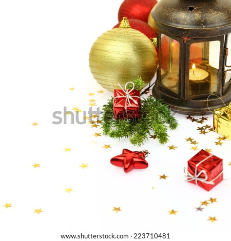 Christmas lantern and ornaments isolated on white - stock photo