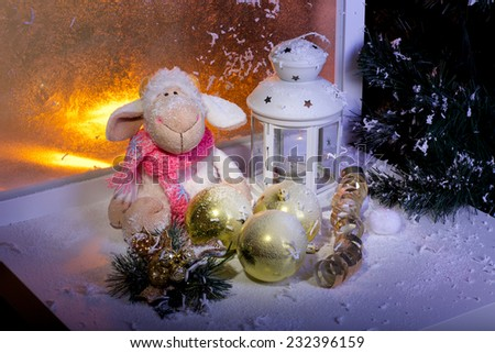 Christmas lantern and toys covered with frost - stock photo