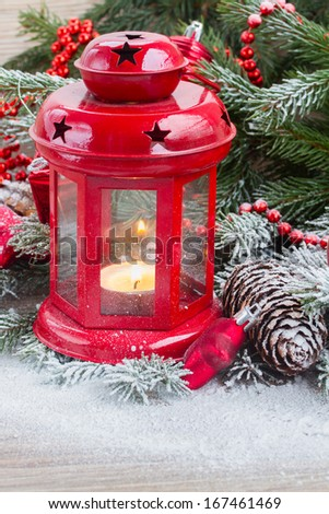 christmas lantern close up  with evergreen tree and snow