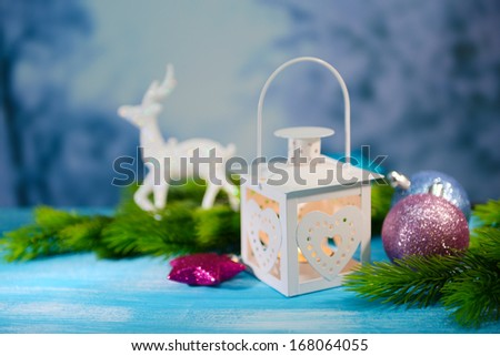 Christmas lantern, fir tree and decorations  on light background