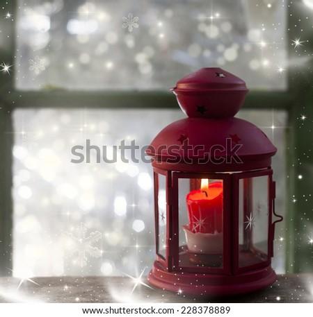 Christmas lantern in window - stock photo