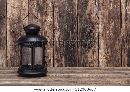 Christmas lantern on old wooden background