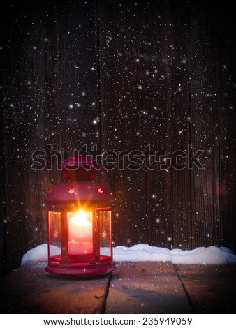 Christmas lantern on vintage wooden background in night  - stock photo