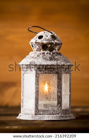 Christmas lantern on wooden background.