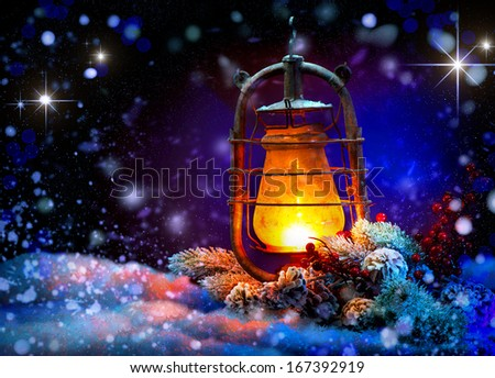 Christmas Lantern with miracle. Magic Stars. Winter Holiday Scene. Beautiful Background with Snow. Burning Old Styled lantern and christmas decoration in the evening. New Year art design  - stock photo