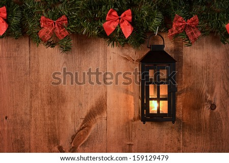 christmas lantern with pine boughs and bows - stock photo