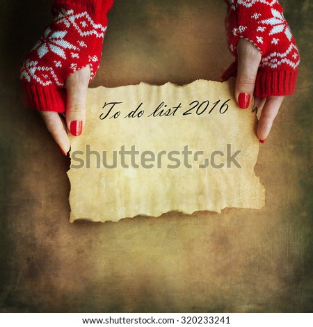 Christmas letter in woman hands - stock photo