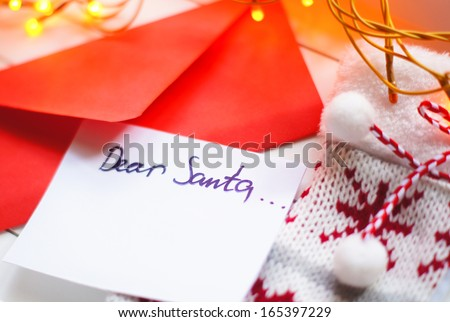 Christmas letter to Santa Claus and different holiday decoration - stock photo