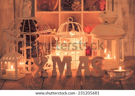 Christmas light and wooden letter decorations in shabby chic style - stock photo
