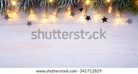Christmas light background  with tree branches and Christmas  lights  - stock photo