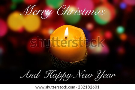 Christmas light candle in color background - stock photo