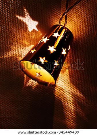 Christmas light decoration: close-up of star shape electric lights - stock photo
