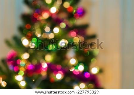 christmas light on tree, abstract defocused background - stock photo