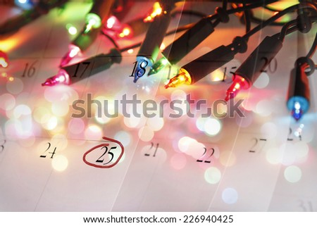 Christmas lights and December calendar - stock photo