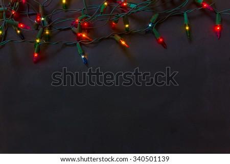 Christmas lights black background - stock photo