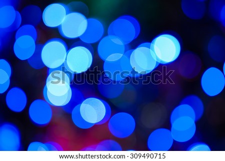 Christmas lights blue bokeh - A blue color bokeh background created by a set of de-focused Christmas lights. - stock photo