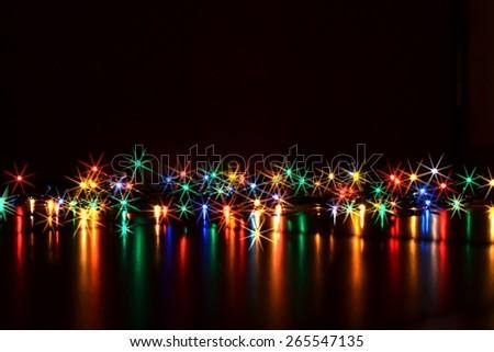 Christmas lights. Christmas lights on a pure black background. Preparing for the Holidays Christmas. Stars. - stock photo