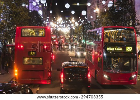 Christmas Lights Display on Oxford Street in London. The modern colourful Christmas lights attract and encourage people to the street.   - stock photo