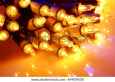 Christmas lights glowing bright closeup - stock photo
