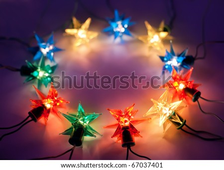 Christmas lights in ring on dark background with copy space.Decorative garland - stock photo