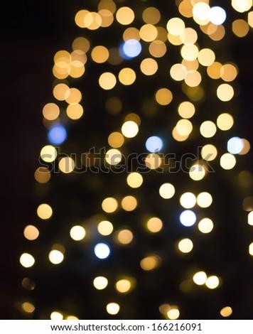Christmas lights in shopping center. Bokeh - stock photo