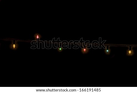 Christmas lights lit  at night isolated on black, Vintage lights - stock photo
