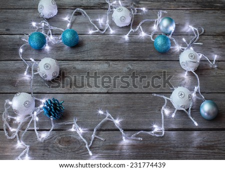 Christmas lights on a wooden background with copy space - stock photo