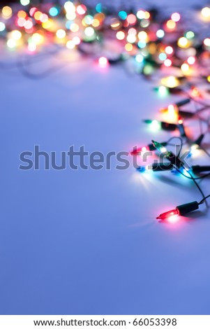Christmas lights on dark blue background with copy space - stock photo